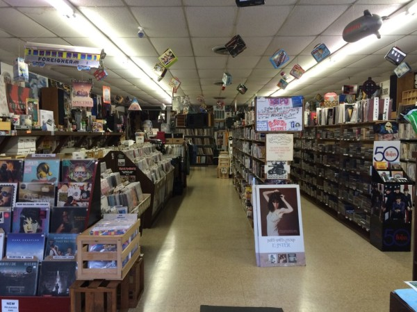 This is what a clean, assiduously organized, well-lit record store looks like, hipsters.
