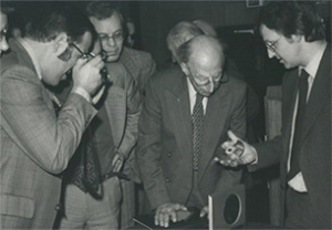 Elderly Dutch men in the late 70s marvel at the CD prototype