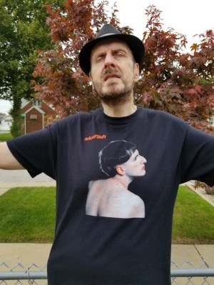 "2019 photo of Jim Skafish wearing ""Skafish"" t-shirt"